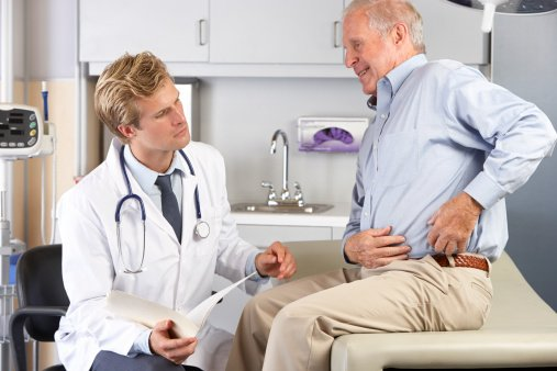 Metal on Metal Hip Implant Patient shows Doctor where Pain is located