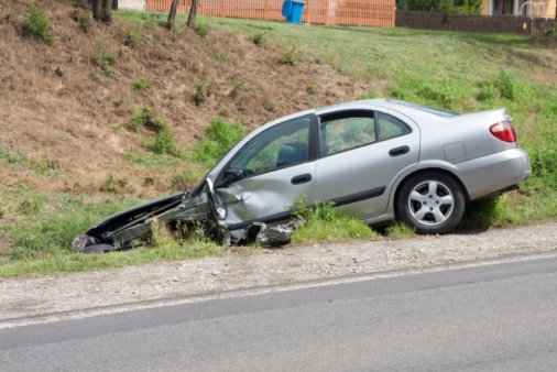 A Car has rolled off a Chicago road after having a Rear End Accident.