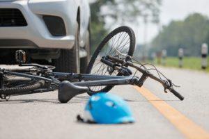 What happens if a bike hits a car door?